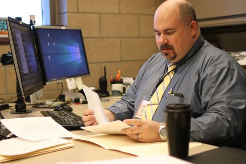 Captain Andrew Frobig at his desk at the Cass County Jail - photograph by C.S. Hagen
