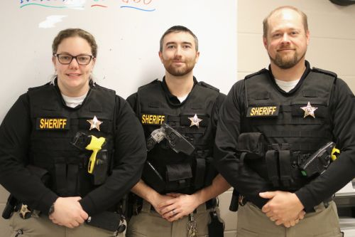 Left to right - Deputy Ashley Bates, Deputy Eric Benson, and Corporal Chad Violet of the Community Supervision Unit - photograph by C.S. Hagen
