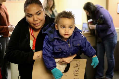Jessica Perez and her son Malachi after signing the letter to Congressman Kevin Cramer urging him to help Savanna's Act pass - photograph by C.S. Hagen