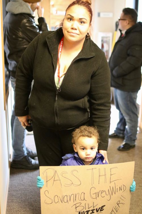 Jessice Perez and son Malachi outside of Congressman Kevin Cramer's office - photograph by C.S. Hagen