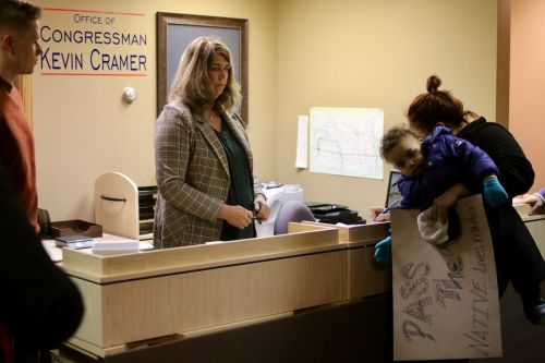 Petitioners sign letter to Congressman Kevin Cramer urging him to help Savanna's Act pass - photograph by C.S. Hagen