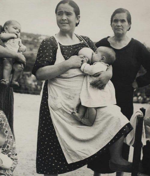 Unidentified mother nursing her baby - Facebook