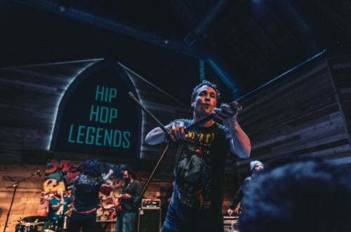 Kipp G hyping up the crowd again during a Tribe Called Quest - photograph by Sean Rider