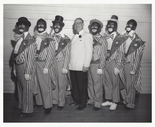 Performers in blackface pose for a photograph at the Fargo Elks Lodge