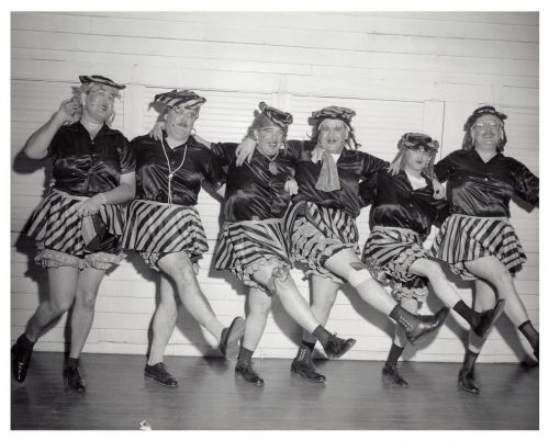 Male performers in women's clothing dancing at the Fargo Elks Lodge
