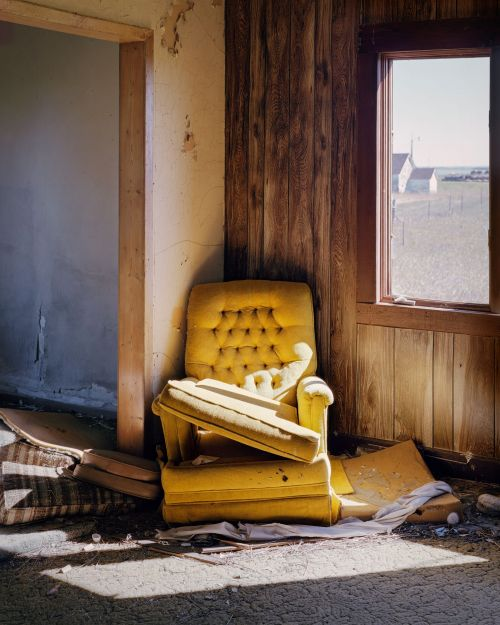 Chair in abandoned house, Arena, North Dakota - photograph by Lew Ableidinger