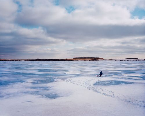 Ice fishing near Eckelson, North Dakota - photograph by Lew Ableidinger