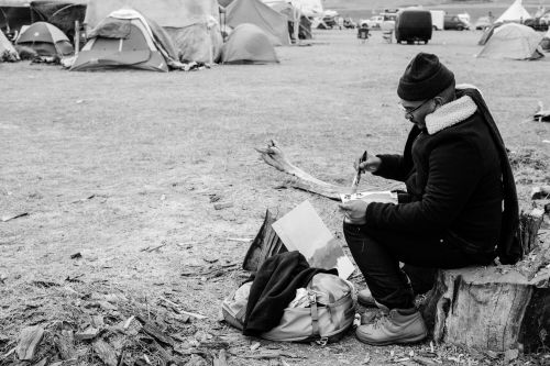 Patrick Martinez at DAPL camps - photograph by Estevan Oriol