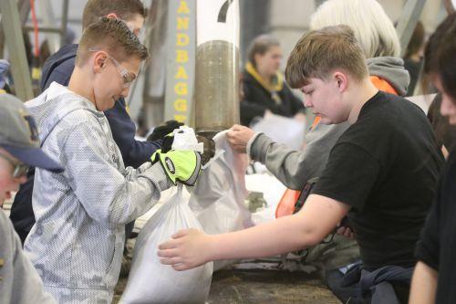 Fargo students sandbagging - photograph by C.S. Hagen
