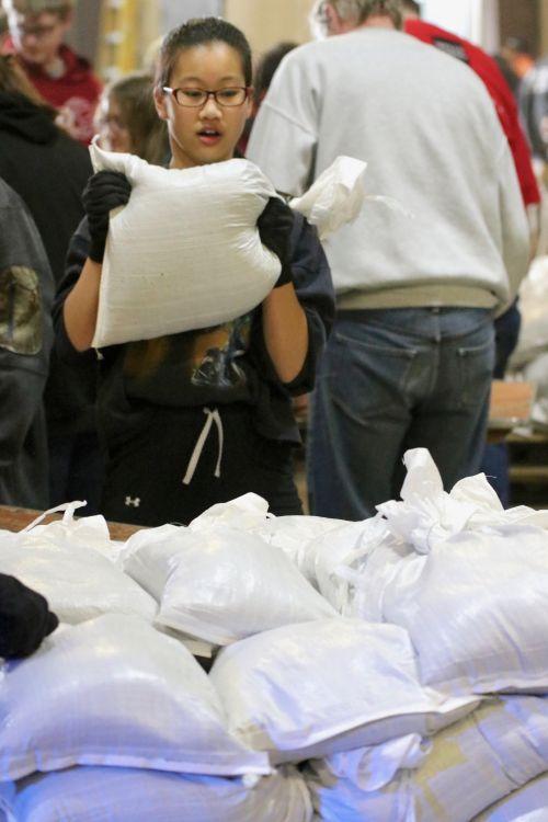 Many schools - primarily 8th graders - from Fargo and West Fargo are volunteering to help sandbag - photograph by C.S. Hagen