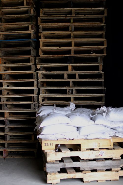 Pallets and sandbags in light - photograph by C.S. Hagen