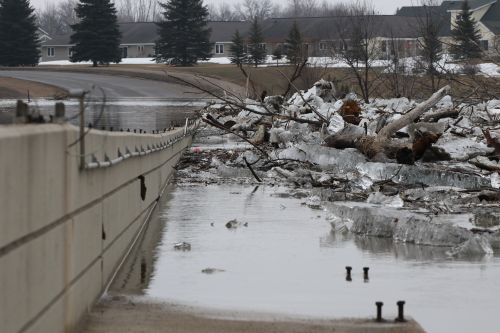 Ice jam against 12th Avenue Bridge crossing into Moorhead, MN - photograph by C.S. Hagen