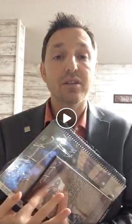 Screenshot of Jake MacAuley after North Dakota speech holding up paraphenalia - Facebook