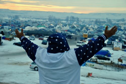 An Native activist at the No-DAPL camps praying at dawn - photograph by C.S. Hagen