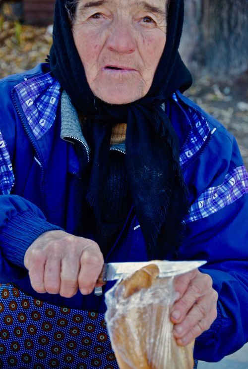 A mother, a grandmother, selling cheese in Transylvania, Romania - photograph by C.S. Hagen