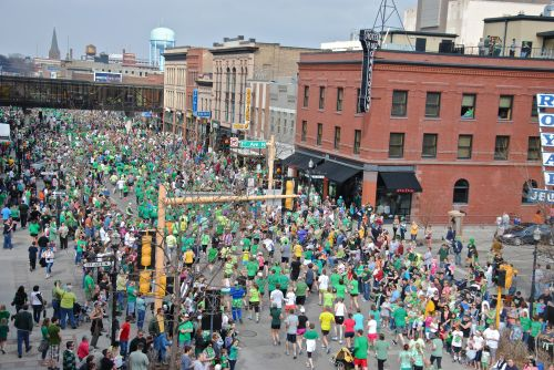 Runners in race through downtown Fargo - photograph by C.S. Hagen