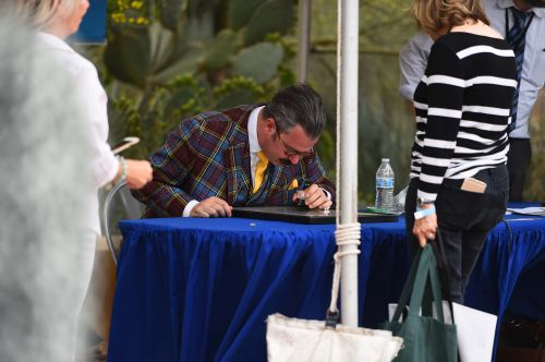 Nicholas Lowry center appraises an item at the ANTIQUES ROADSHOW production event on Tuesday, April 16, 2019 at the Desert Botanical Garden in Phoenix, AZ. - photograph by Meredith Nierman for WGBH