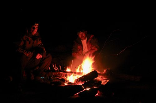 Sitting around the fire while camping in Xinjiang, China - photograph by C.S. Hagen