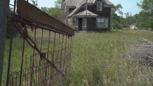 Miranda house and fence - South Dakota Public Broadcasting producer Stephanie Rissler