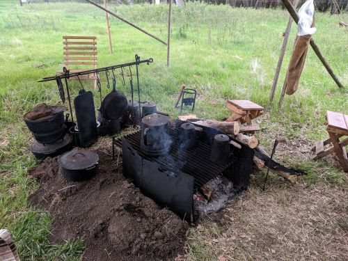 Campfire with true cookware of the time period - photograph by Ryan Janke