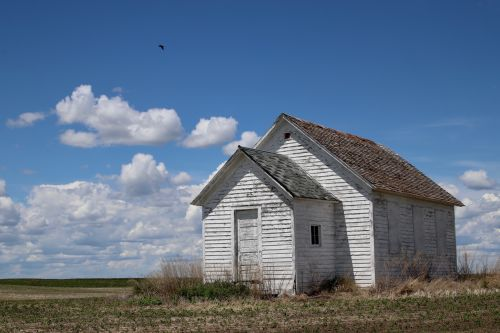 An abandoned building outside of Tuttle - photograph by C.S. Hagen