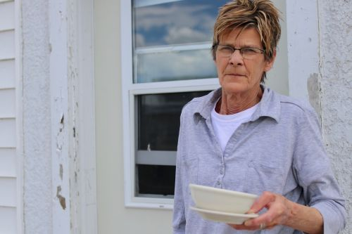 Carol Steichen and a bowl of her famous Knoephla soup - photograph by C.S. Hagen