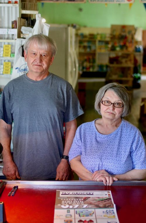 Following their parents' footsteps Terry Gruebele and his sister Verleen have been running the T & V Grocery Store in Pettibone for 33 years - photograph by C.S. Hagen