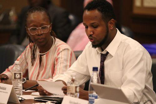 Hukun Abdullahi and Laetitia Mizero Hellerud - Advocate and Social Justice Activist - offering testimony - photograph by C.S. Hagen