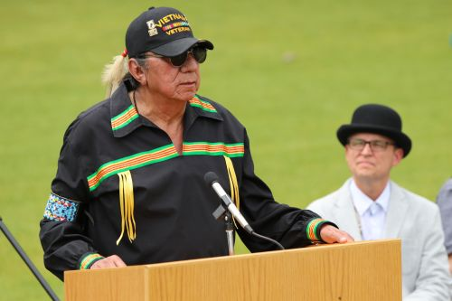 Great grandson of Sitting Bull - Ernie LaPointe - speaking - photograph by C.S. Hagen