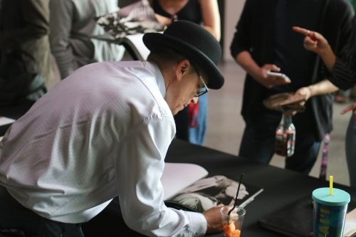 Shane Balkowitsch signing his book - photograph by C.S. Hagen