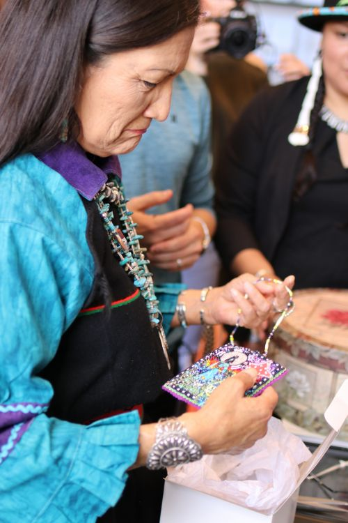 Congresswoman Debra Haaland comes close to tears after receiving handmade gifts - photograph by C.S. Hagen