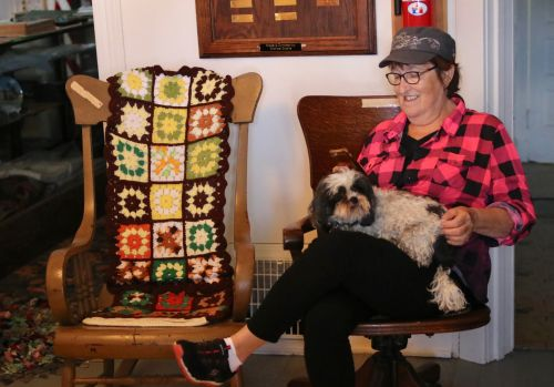 Carmen Rath-Wald and her dog Lucy at the Logan County Historical Society in Napoleon - photograph by C.S. Hagen