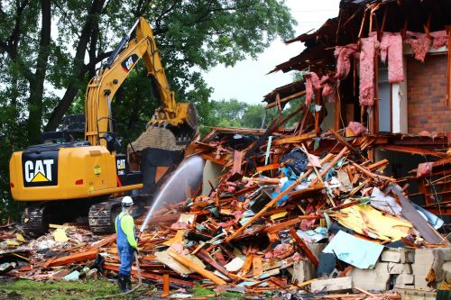 Houses being torn down for th eNewman Center project - photograph by C.S. Hagen