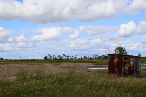 Brine spills and rusted tanks litter the fields in Bottineau County - photograph by C.S. Hagen
