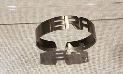 Bracelet from the 1970s with cutout reading ERA referring to the Equal Rights Amendment - photograph provided by SHSND