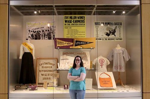 Elise Dukart standing in front of her exhibit - photograph provided by SHSND
