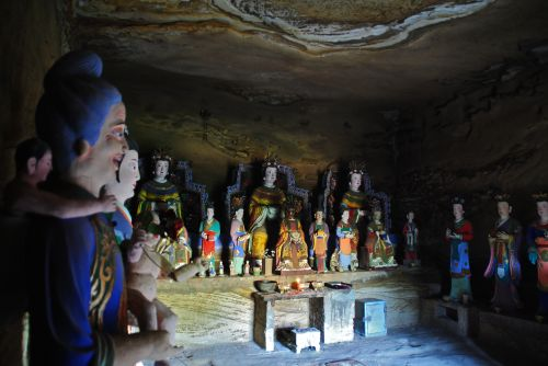 A benevolent family of gods and minor deities in a cave in Shaanxi Province - photograph by C.S. Hagen