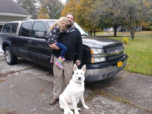 Aaron Dorn, his daughter Lily, their dog Odin, and the 2003 Chevy Silverado - photograph provided by Aaron Dorn