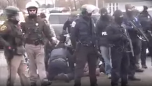 Police knee-ing Aaron Dorn in a dogpile - police cam footage screenshot