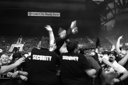 Security managing crowd surfers during Ministry's set - photograph by Sabrina Hornung