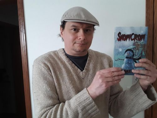 Darrin Albert holding a copy of Snowcrow. photo courtesy of John Showalter