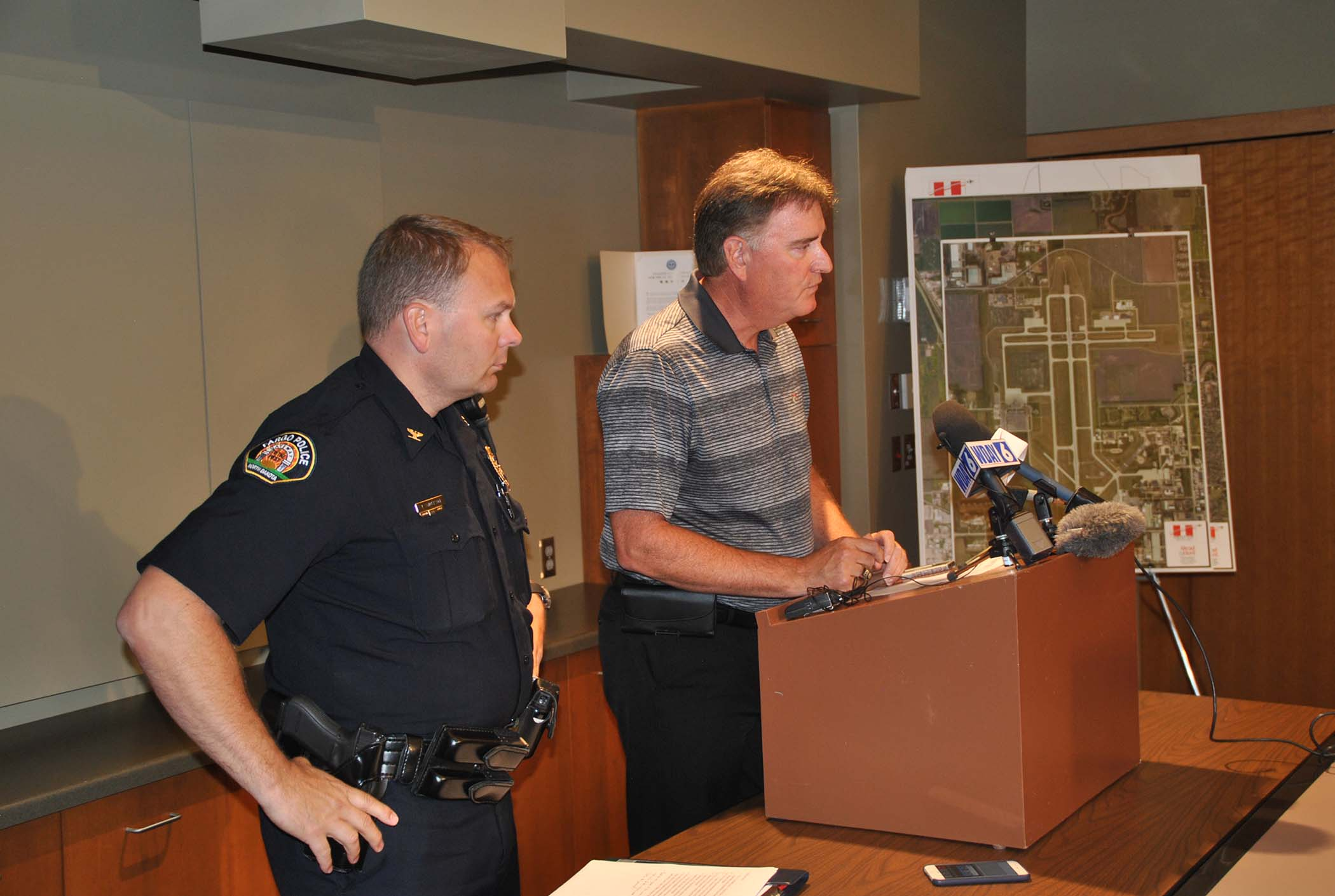 Airpot Authority Executive Director Shawn Dobberstein and Fargo Police Deputy Chief Jospeh Anderson call a press conference to relay details about the death at Hector Airport early Monday morning - photo by C.S. Hagen