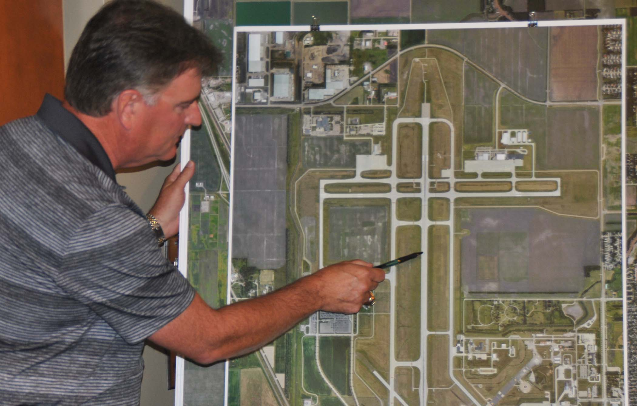 Airpot Authority Executive Director Shawn Dobberstein points to where the accident occurred - photo by C.S. Hagen