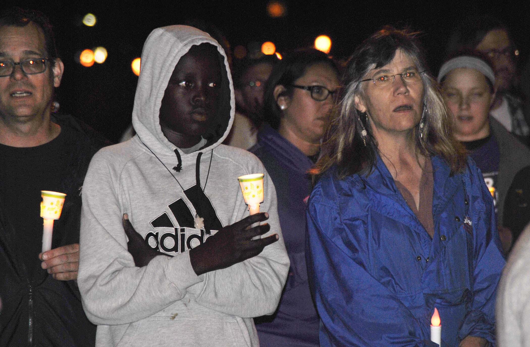 Candle lit vigil on Veterans Memorial Bridge to remember Heather Heyer - photo by C.S. Hagen