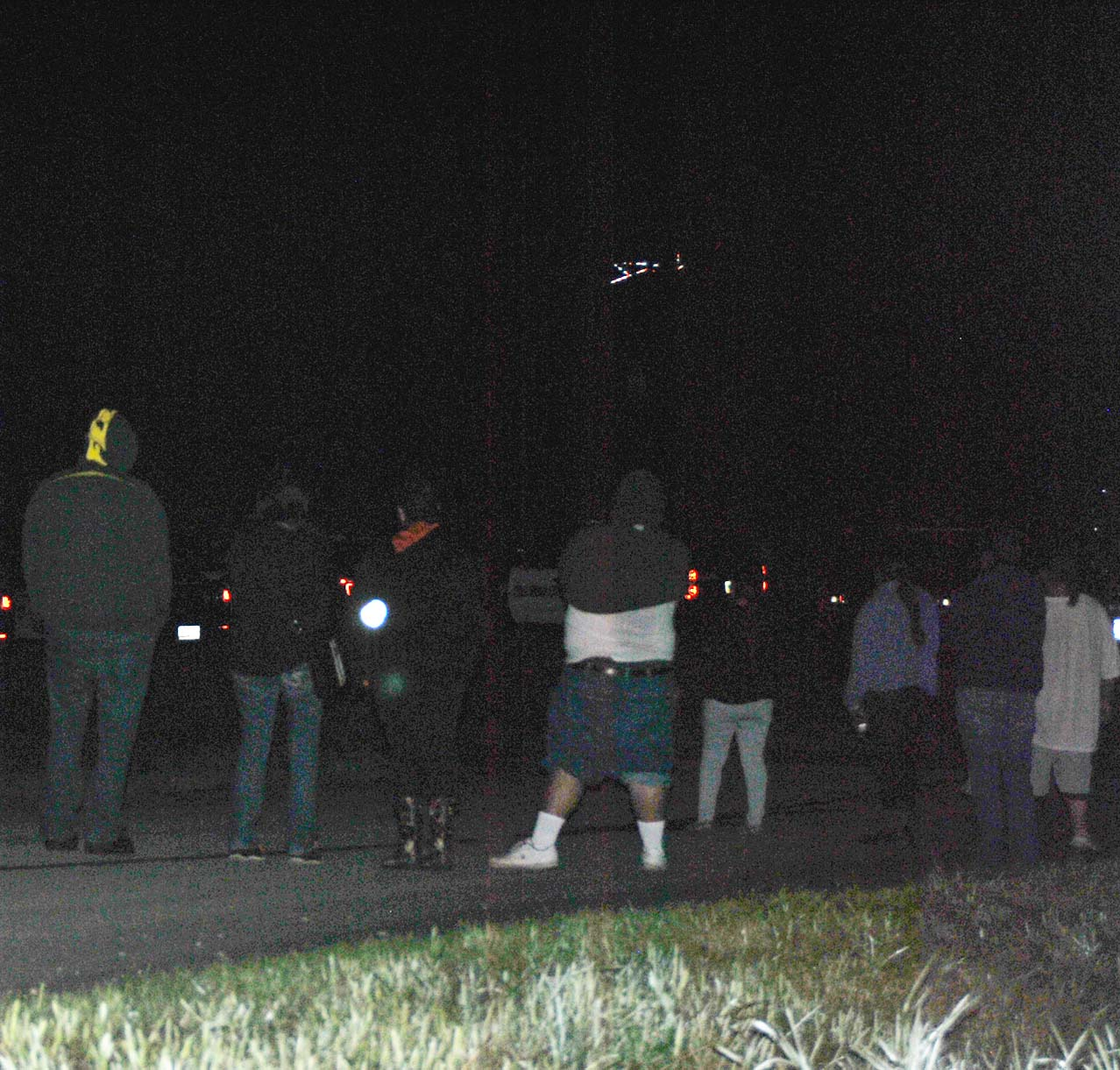 Greywind's family and friends watching while police search forest early Sunday morning along Red River banks in Moorhead, Minnesota - photo by C.S. Hagen