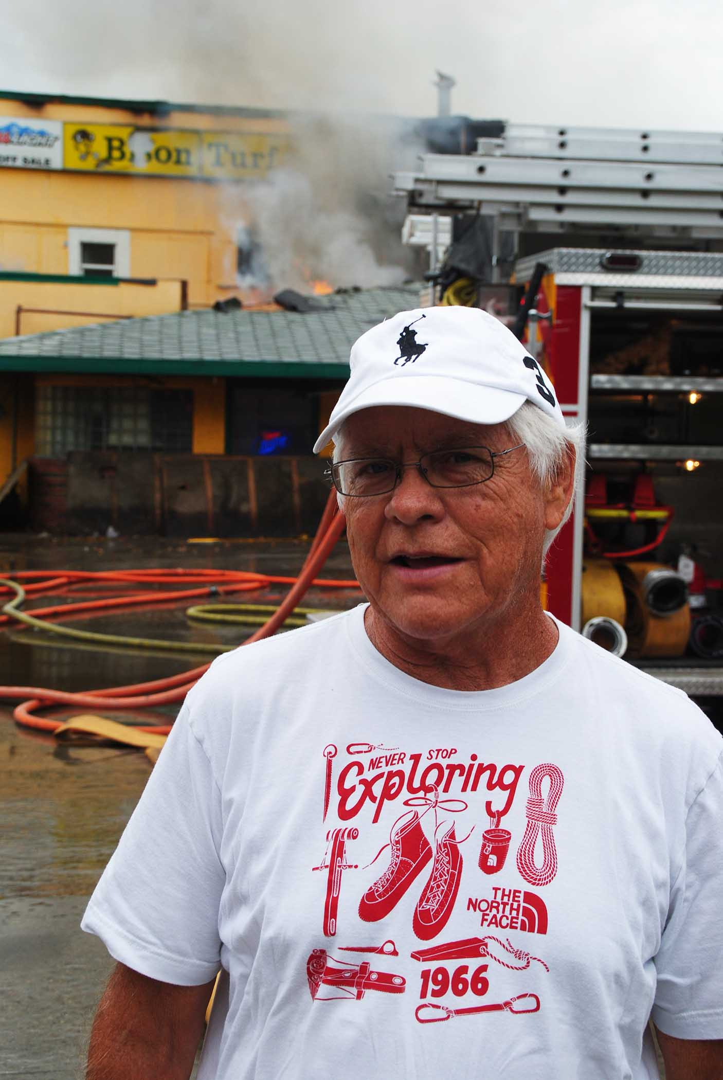 James Sabo before his burning restaurant in July 2016 - photo by C.S. Hagen