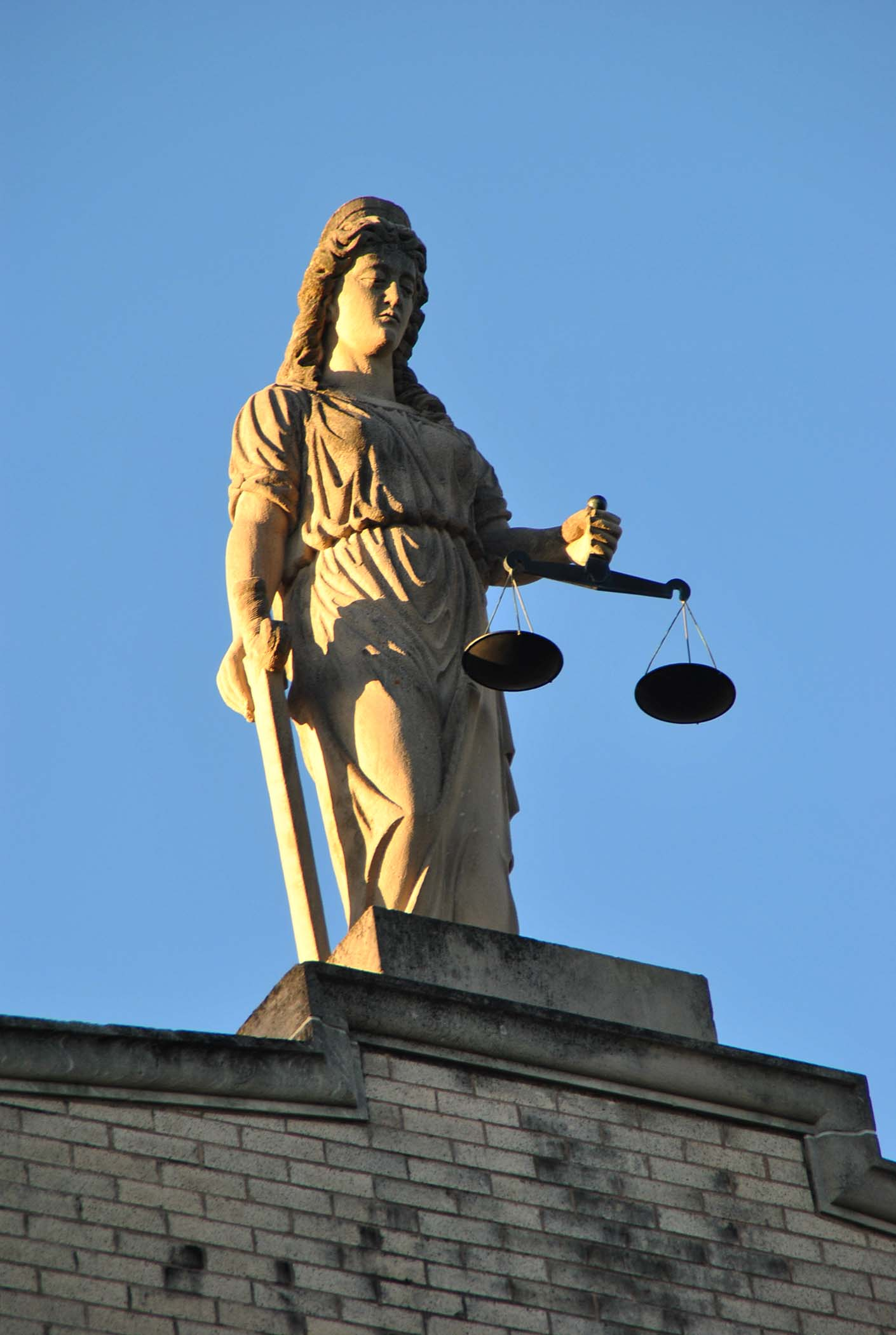 Lady Justice atop the Pembina County Courthouse - photo by C.S. Hagen