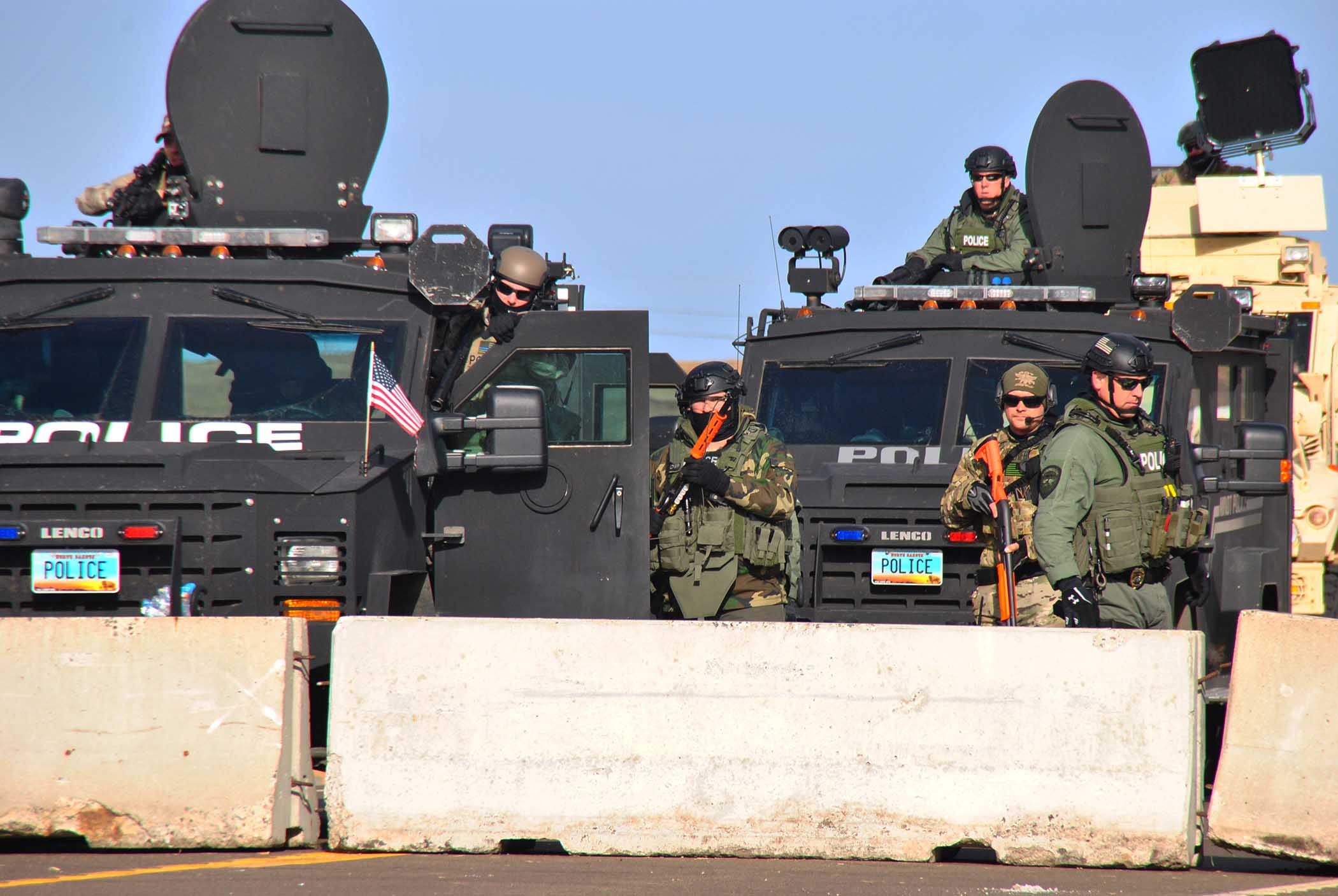 Law enforcement from four states standoff against activistts from and supporting Standing Rock - photo by C.S. Hagen