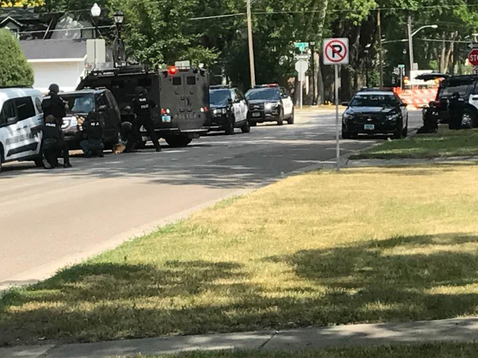 Police and SWAT teams surround North Fargo apartment after gunshot