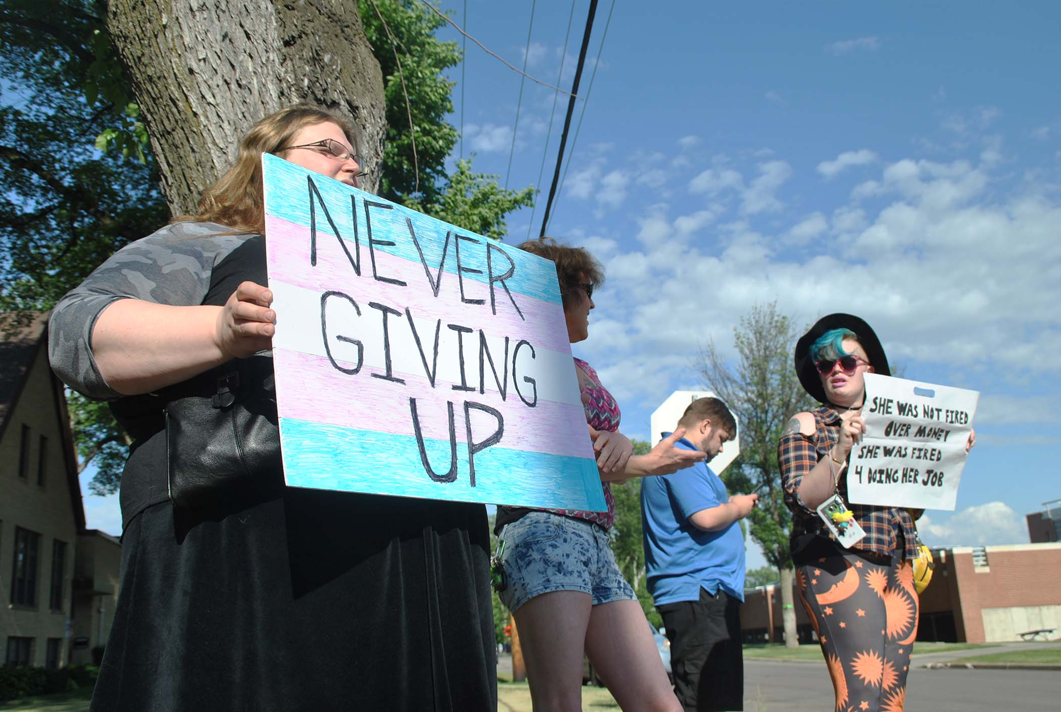 Protesters gather outside of Plymouth Congregational United Church of Christ - photo by C.S. Hagen
